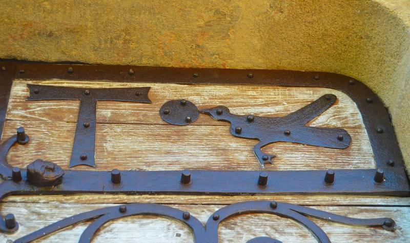 Pentures de la porte d'entrée, détail