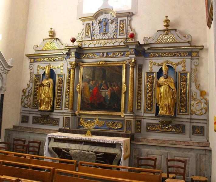 Retable de l'Eucharistie, avec son tableau : Cène, et ses deux statues : Saints évêques