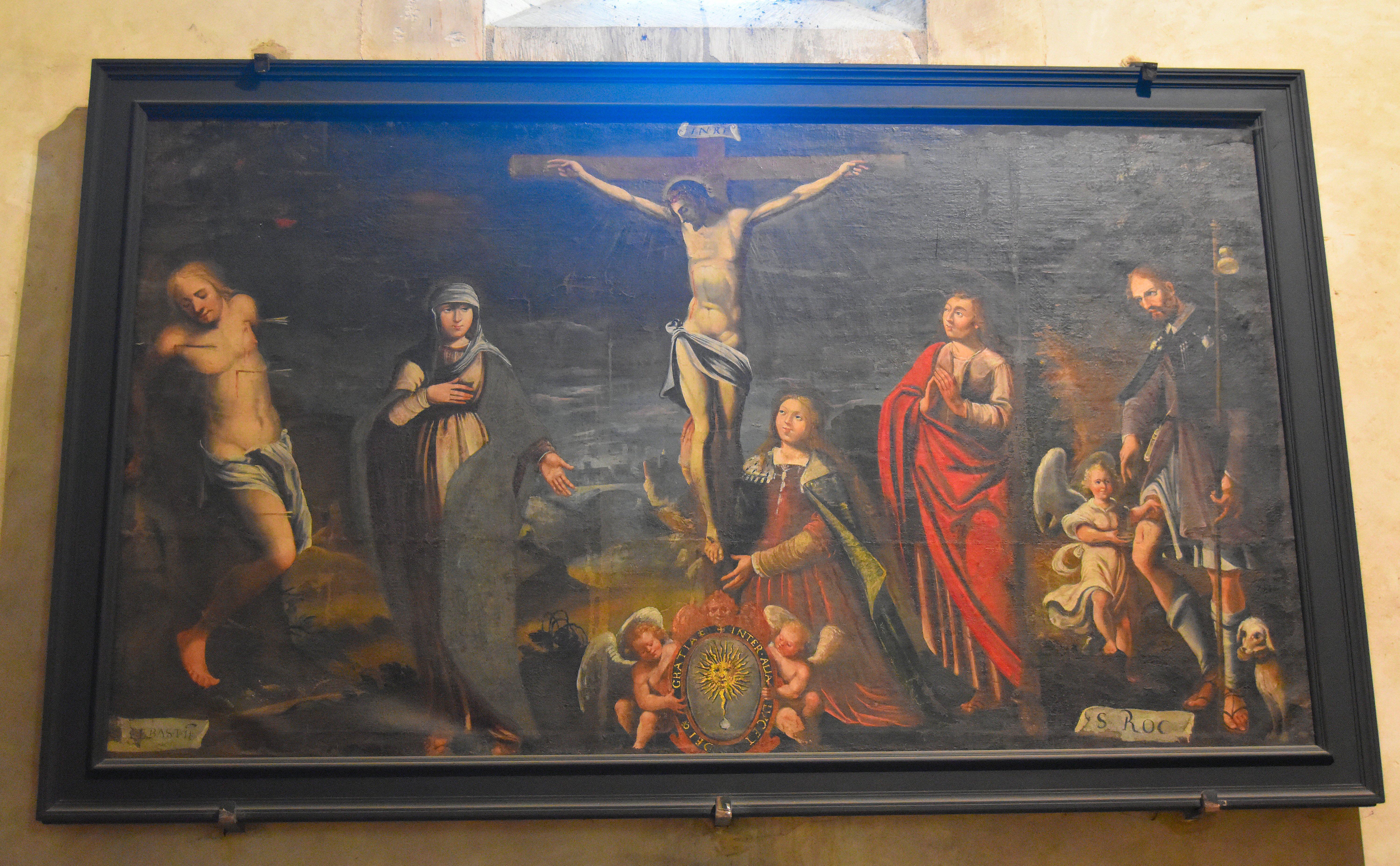 Tableau : Crucifixion du Christ avec la Vierge Marie, saint Jean et sainte Marie Madeleine au pied de la croix, les saints Sébastien et Roch de part et d'autre