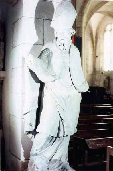 groupe sculpté : saint évêque barbu et tête d'enfant