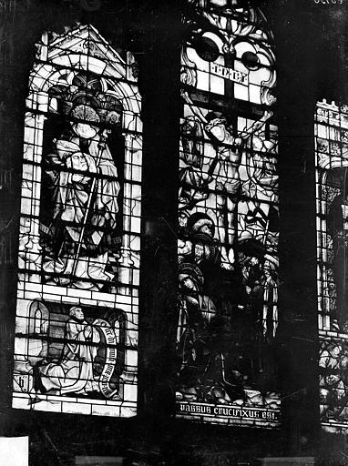 Vitrail de la chapelle de l'Assomption : un saint portant sa tête, Crucifixion