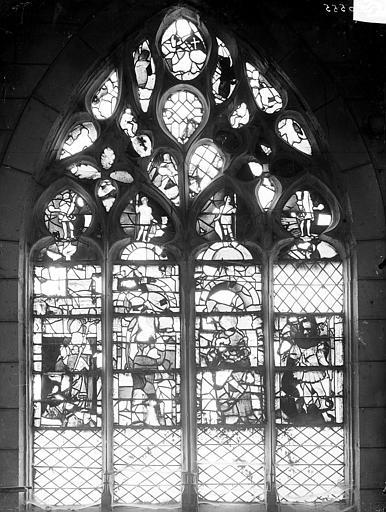 Vitrail du bas-côté nord de la nef, deuxième travée ouest : quatre saints (un évêque, un saint, la Vierge à l'Enfant, saint Michel)