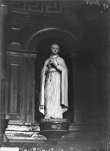 Statue de saint François en terre cuite