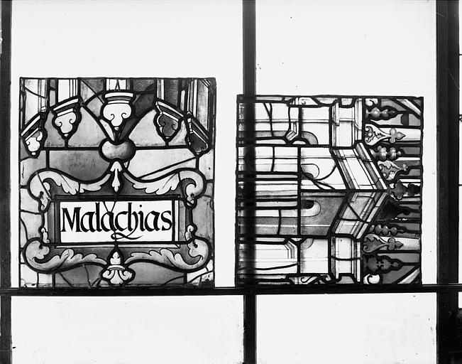 Deuxième galerie, portail sud, lancette de Malachie, titulus et détail du dais