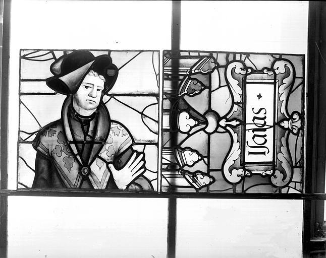 Deuxième galerie, portail sud, lancette d'Isaïe, titulus et tête à l'envers