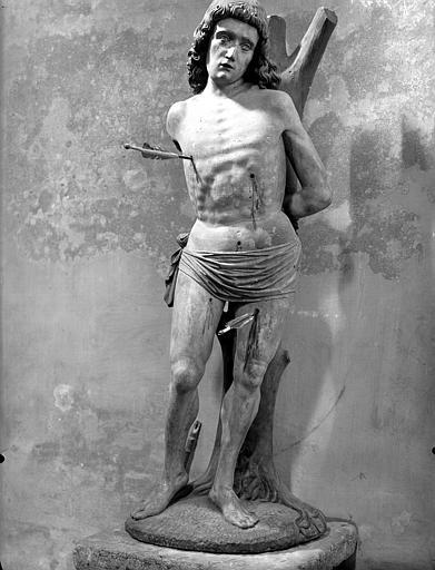 Saint Sébastien. Statue en pierre : saint Sébastien