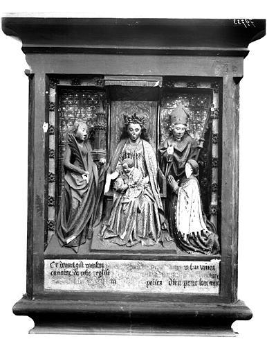 Monument d'un chanoine. Monument funéraire d'un chanoine : Vierge à l'Enfant, sainte Barbe et le donateur accompagné d'un saint évêque