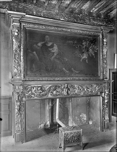 Cheminée en bois sculpté et peinture sur toile : Madeleine visitée par les anges