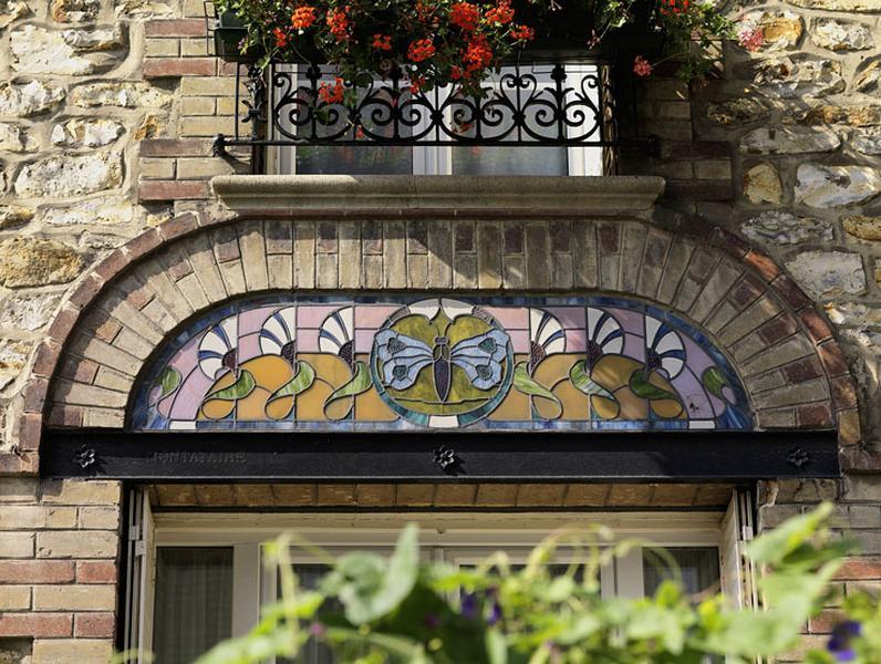 2 verrières décoratives : papillons et liserons
