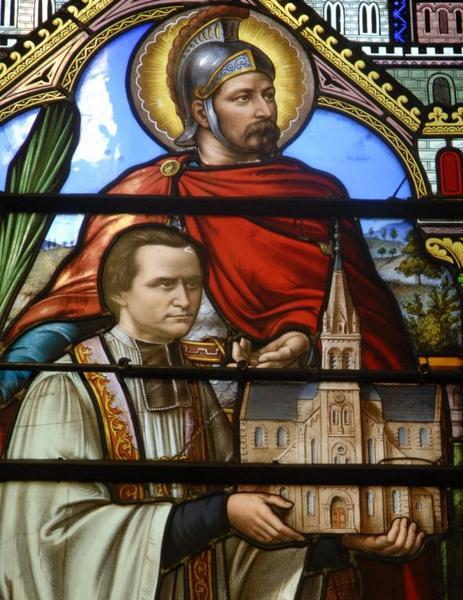 Verrière représentant l'abbé Desgenest présentant l'église Saint-Sébastien à la Vierge
