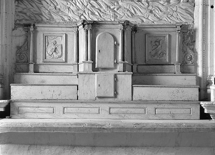 Retable architecturé et tabernacle à ailes du maître-autel