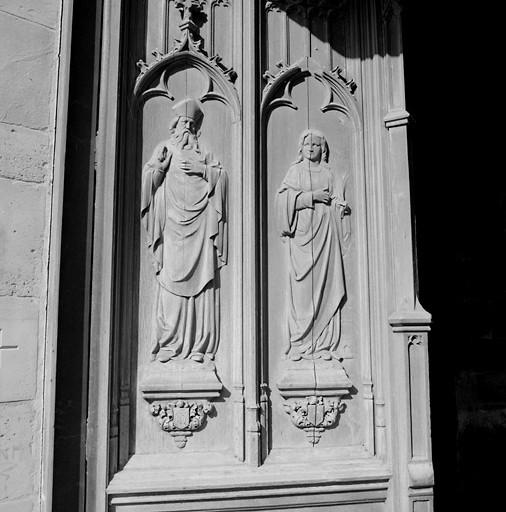 2 vantaux de style néo-gothique à bas-reliefs : saint Martin (?), sainte Barbe, saint Luc et saint Eloi