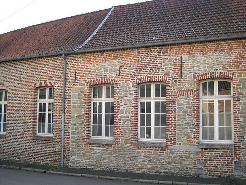 Ensemble de 2 maisons, puis école primaire de filles et école primaire de garçons, actuellement école de musique et ateliers municipaux