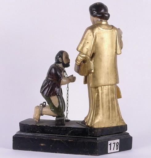 groupe sculpté : saint Léonard et un prisonnier