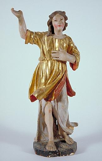 Statuette : personnage levant le bras gauche