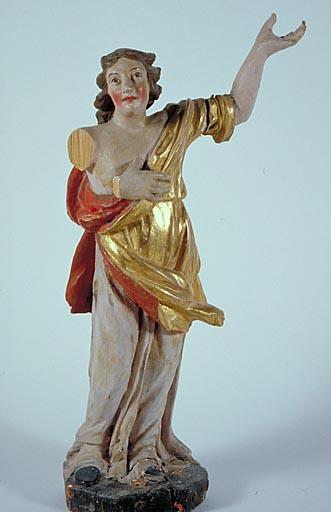 Statuette : personnage levant le bras droit