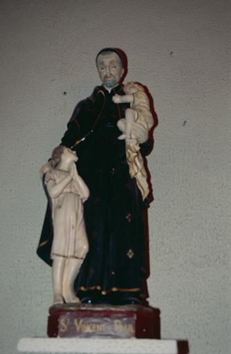 Groupe sculpté : Saint Vincent de Paul et deux enfants trouvés