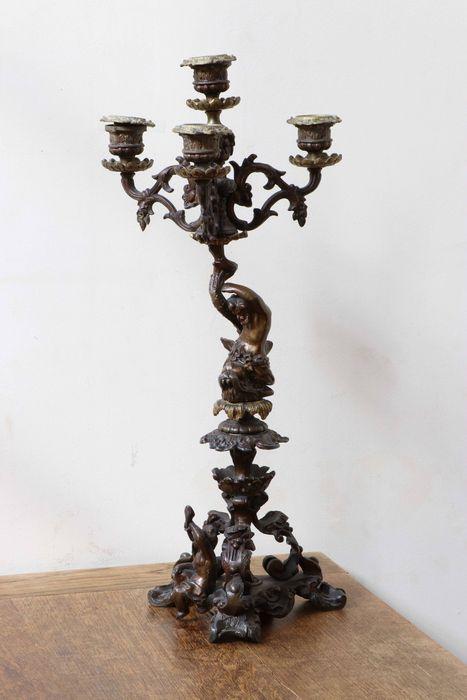 2 chandeliers dits aux tritons