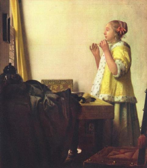 La femme au collier de perles (Vrouw met parelsnoer) c. 1664, huile sur toile (55 x 45 cm) Staatliche Museen Preußischer, Kulturbesitz, Gemäldegalerie, Berlin
