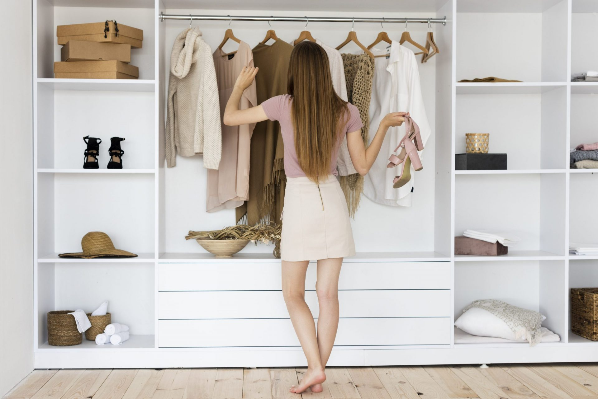 long-shot-woman-looking-through-her-clothes